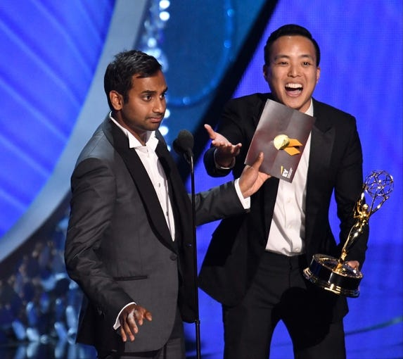 Sep 18, 2016; Los Angeles, CA, USA;  Aziz Ansari (left) and Alan Yang accept the award for Outstanding Writing For A Comedy Series for the Netflix series    Master of None    