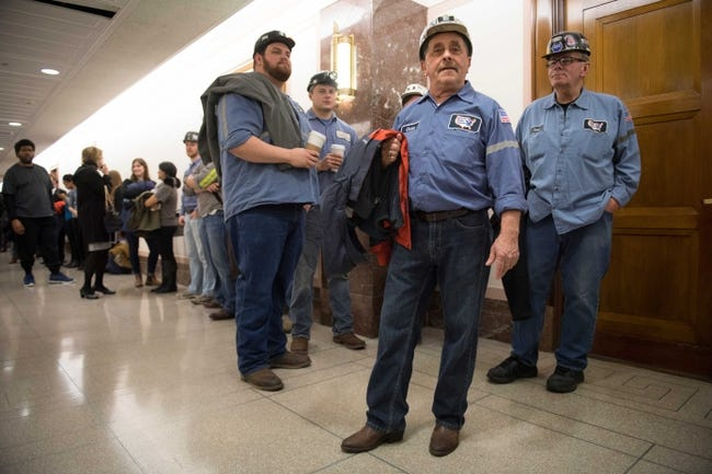 Jan 18, 2017; Washington, DC, USA;  Coal miner Danny Hayes from the Century Mine from St. Clarksville, Ohio, arrives with other miners and large crowds before the nomination hearing for Scott Pruitt, nominee for Administrator of the EPA, during confirmation hearing before the Senate Environment and Public Works Committee.  Mandatory Credit: Jack Gruber-USA TODAY NETWORK