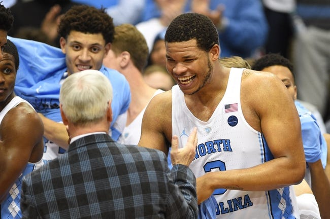 Jan 16, 2017; Chapel Hill, NC, USA; North Carolina Tar Heels head coach Roy Williams with forwards Justin Jackson (44) and Kennedy Meeks (3) in the second half. The Tar Heels defeated Syracuse Orange 85-68 at Dean E. Smith Center. Mandatory Credit: Bob Donnan-USA TODAY Sports