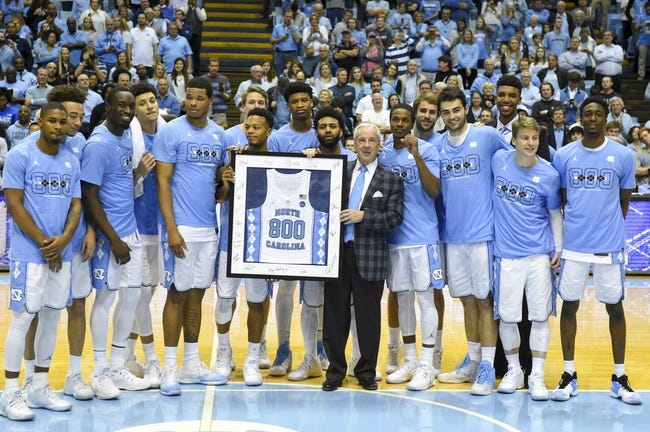 Jan 16, 2017; Chapel Hill, NC, USA; North Carolina Tar Heels head coach Roy Williams with his team after Williams 800th coaching victory. The Tar Heels defeated Syracuse Orange 85-68 at Dean E. Smith Center. Mandatory Credit: Bob Donnan-USA TODAY Sports