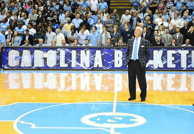 Jan 16, 2017; Chapel Hill, NC, USA; North Carolina Tar Heels head coach Roy Williams watches a video during a celebration after Williams 800th coaching victory. The Tar Heels defeated Syracuse Orange 85-68 at Dean E. Smith Center. Mandatory Credit: Bob Donnan-USA TODAY Sports