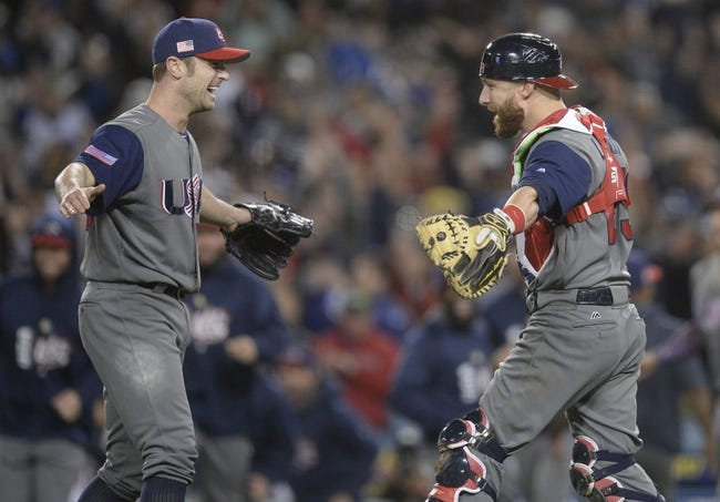 Mar 22, 2017; Los Angeles, CA, USA; USA pitcher David Robertson (30) and catcher Jonathan Lucroy (25) celebrate the 8-0 championship victory against Puerto Rico during the 2017 World Baseball Classic at Dodger Stadium. Mandatory Credit: Gary A. Vasquez-USA TODAY Sports