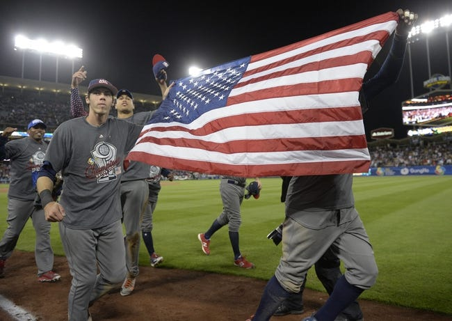 Mar 22, 2017; Los Angeles, CA, USA; USA outfielder Christian Yelich (7) celebrates the 8-0 victory against Puerto Rico following the 2017 World Baseball Classic at Dodger Stadium. Mandatory Credit: Gary A. Vasquez-USA TODAY Sports