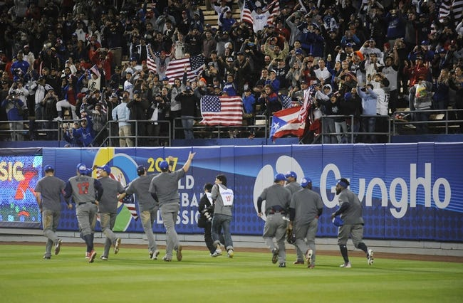 Mar 22, 2017; Los Angeles, CA, USA; USA players celebrate the 8-0 championship victory against Puerto Rico following the 2017 World Baseball Classic at Dodger Stadium. Mandatory Credit: Gary A. Vasquez-USA TODAY Sports