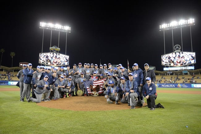 Mar 22, 2017; Los Angeles, CA, USA; USA players pose for a group photo following the 8-0 championship victory against Puerto Rico in the 2017 World Baseball Classic at Dodger Stadium. Mandatory Credit: Gary A. Vasquez-USA TODAY Sports