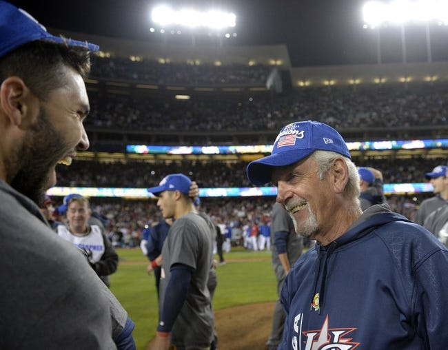 Mar 22, 2017; Los Angeles, CA, USA; USA infielder Eric Hosmer (35) speaks with manager Jim Leyland (11) following the 8-0 victory against Puerto Rico in the 2017 World Baseball Classic at Dodger Stadium. Mandatory Credit: Gary A. Vasquez-USA TODAY Sports