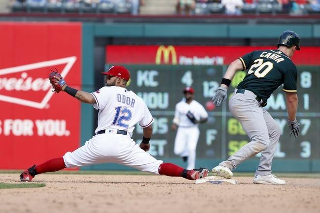 Davis hits 7th home run as A's rout Rangers 9-1