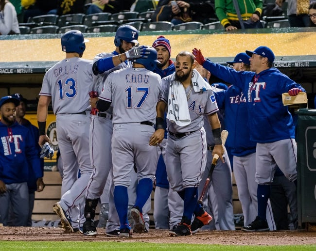 Griffin sharp in return to Oakland as Rangers top A's 7-0