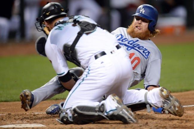 Tomas, Peralta power Diamondbacks past Dodgers 11-5