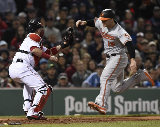 Miley's pitching, 4 HRs carry Orioles past Red Sox 7-5