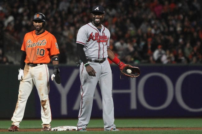 Cueto bounces back as Giants top Braves 7-1