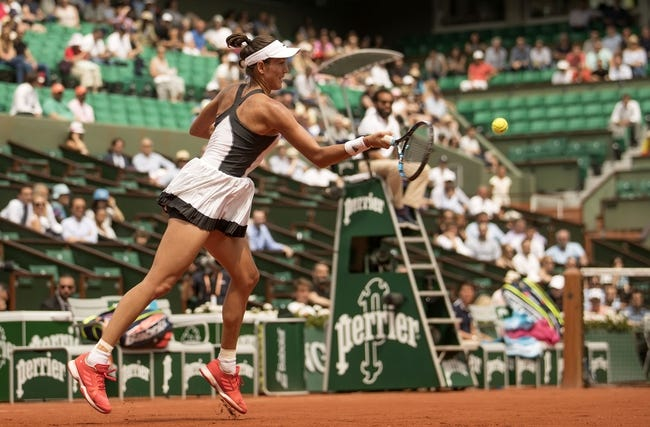 Emotional Muguruza unhappy with partisan French Open crowd as title defence ends