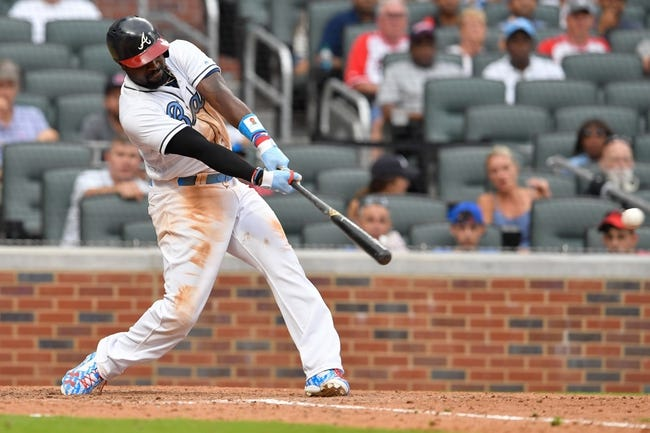 Phillips wins it again as Braves top Marlins 5-4