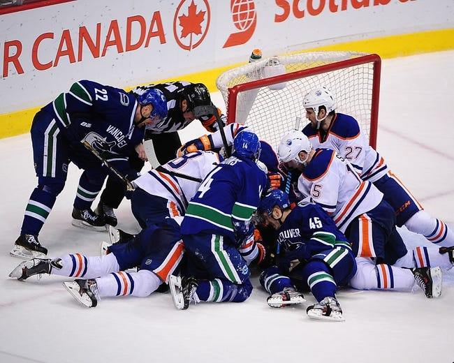 Edmonton Oilers vs. Vancouver Canucks - 4/12/14