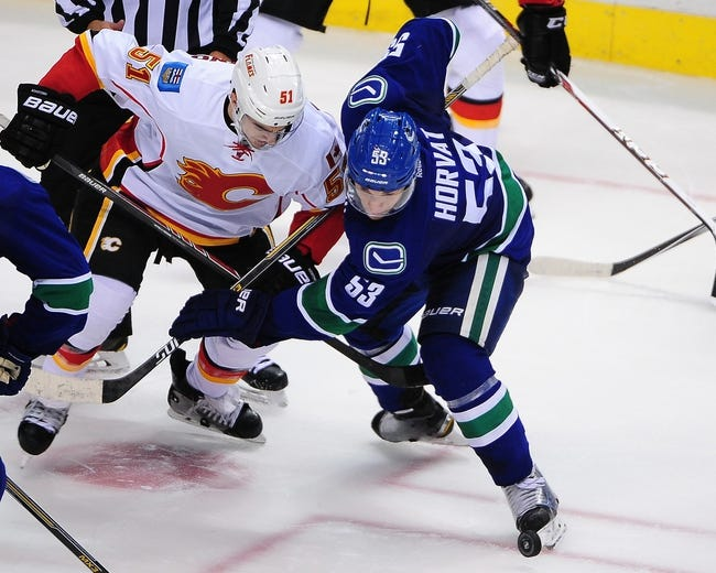 Calgary Flames vs. Vancouver Canucks - 10/8/14