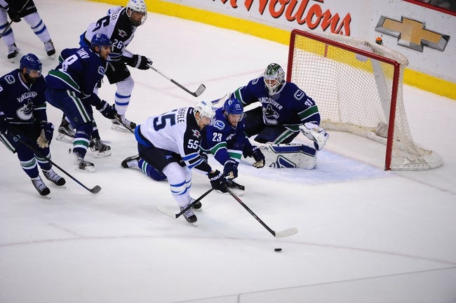 Jets vs. Canucks - 4/4/15 NHL Pick, Odds, and Prediction