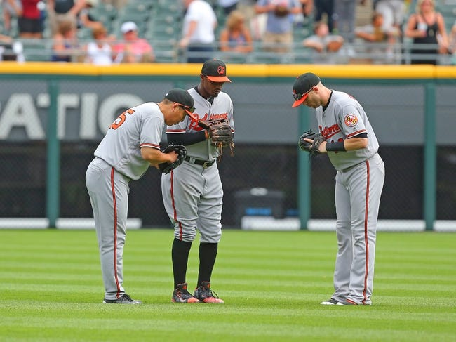 Orioles edge White Sox with Machado and Mancini homers