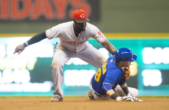 Reds lose a starter, but Winker's double beats Brewers 7-5