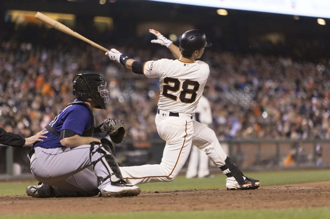 Giants' Parker injured crashing into left-field wall