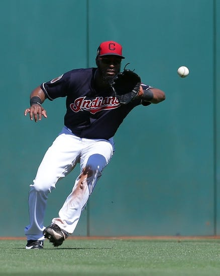 Edwin Encarnacion's 2 homers lead Indians over Reds 8-7