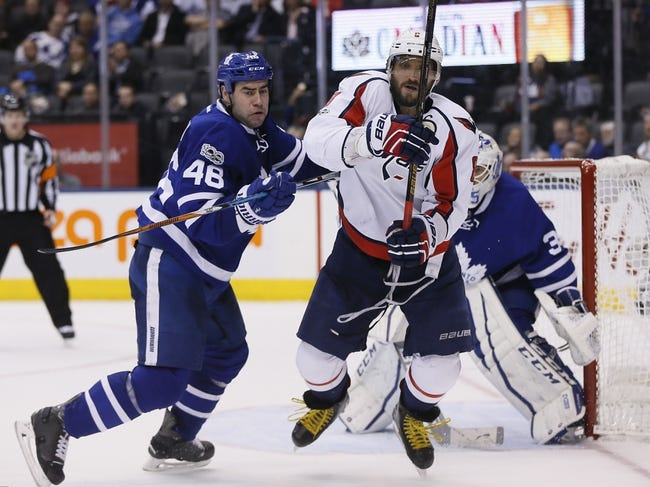 Wilson scores in OT as Caps survive scare to beat Leafs