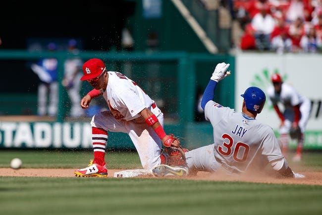 Martinez, Cards beat Cubs; Maddon grumbles over slide rule