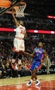 Mar 31, 2013; Chicago, IL, USA; Chicago Bulls small forward Jimmy Butler (21) dunks over Detroit Pistons point guard Rodney Stuckey (3) during the second half at the United Center. The Chicago Bulls defeated the Detroit Pistons 95-94. Mandatory Credit: David Banks-USA TODAY Sports