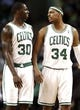 Apr 3, 2013; Boston, MA, USA; Boston Celtics forward Paul Pierce (34) talks with teammate Boston Celtics forward Brandon Bass during the second quarter of an NBA game at TD Garden. Mandatory Credit: Winslow Townson-USA TODAY Sports