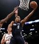 Apr 6, 2013; Brooklyn, NY, USA; Charlotte Bobcats guard Gerald Henderson (9) puts up a shot against Brooklyn Nets center Brook Lopez (11) in the first quarter at Barclays Center. Mandatory Credit: Nicole Sweet-USA TODAY Sports
