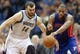 Apr 6, 2013; Minneapolis, MN, USA; Minnesota Timberwolves center Nikola Pekovic (14) and Detroit Pistons center Greg Monroe (10) fight for a loose ball in the second half at Target Center. The Timberwolves won 107-101. Mandatory Credit: Jesse Johnson-USA TODAY Sports