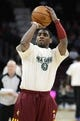 Apr 7, 2013; Cleveland, OH, USA; Cleveland Cavaliers point guard Kyrie Irving (2) warms up prior to the game against the Orlando Magic at Quicken Loans Arena. Mandatory Credit: Eric P. Mull-USA TODAY Sports