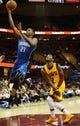 Apr 7, 2013; Cleveland, OH, USA; Orlando Magic small forward Maurice Harkless (21) drives past Cleveland Cavaliers point guard Kyrie Irving (2) during the game at Quicken Loans Arena. Mandatory Credit: Eric P. Mull-USA TODAY Sports