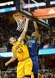 Apr 7, 2013; Cleveland, OH, USA; Orlando Magic small forward Tobias Harris (12) dunks as Cleveland Cavaliers center Tyler Zeller (40) fouls during the game at Quicken Loans Arena. Mandatory Credit: Eric P. Mull-USA TODAY Sports