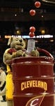 Apr 7, 2013; Cleveland, OH, USA; Cleveland Cavaliers mascot Moondog shoots balls into the crowd during a timeout in the game against the Orlando Magic at Quicken Loans Arena. Mandatory Credit: Eric P. Mull-USA TODAY Sports
