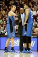 Apr 7, 2013; Cleveland, OH, USA; Orlando Magic head coach Jacque Vaughn talks with point guard Beno Udrih (19) and small forward Tobias Harris (12) during a timeout against the Cleveland Cavaliers during the game at Quicken Loans Arena. Mandatory Credit: Eric P. Mull-USA TODAY Sports