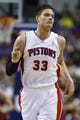 April 7, 2013; Auburn Hills, MI, USA; Detroit Pistons power forward Jonas Jerebko (33) reacts after making a three point shot in the first quarter against the Chicago Bulls at The Palace. Mandatory Credit: Rick Osentoski-USA TODAY Sports