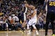 Apr 7, 2013; Oakland, CA, USA; Golden State Warriors guard Stephen Curry (30) is hit in the head while passing the ball around Utah Jazz guard Jamaal Tinsley (6) in the first quarter at ORACLE arena. Mandatory Credit: Cary Edmondson-USA TODAY Sports