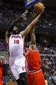April 7, 2013; Auburn Hills, MI, USA; Detroit Pistons center Greg Monroe (10) goes to the basket on Chicago Bulls center Nazr Mohammed (48) in the third quarter at The Palace. Detroit won 99-85. Mandatory Credit: Rick Osentoski-USA TODAY Sports