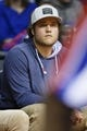 April 7, 2013; Auburn Hills, MI, USA; Detroit Lions quarterback Matthew Stafford watches the game between the Detroit Pistons and the Chicago Bulls at The Palace. Mandatory Credit: Rick Osentoski-USA TODAY Sports