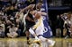 Apr 7, 2013; Oakland, CA, USA; Golden State Warriors guard Stephen Curry (30) attempts to dribble around Utah Jazz forward Derrick Favors (15) in the fourth quarter at ORACLE arena. The Jazz defeated the Warriors 97-90. Mandatory Credit: Cary Edmondson-USA TODAY Sports