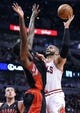 Apr 9, 2013; Chicago, IL, USA; Chicago Bulls power forward Carlos Boozer (5) shoots the ball against Toronto Raptors power forward Amir Johnson (15) during the second half at the United Center. Toronto defeats Chicago 101-98. Mandatory Credit: Mike DiNovo-USA TODAY Sports