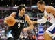 April 10, 2013; Los Angeles, CA, USA; Minnesota Timberwolves point guard Ricky Rubio (9) moves the ball against the defense of Los Angeles Clippers power forward Blake Griffin (32) during the first half at Staples Center. Mandatory Credit: Gary A. Vasquez-USA TODAY Sports
