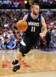 April 10, 2013; Los Angeles, CA, USA; Minnesota Timberwolves point guard J.J. Barea (11) moves the ball up court against the Los Angeles Clippers during the first half at Staples Center. Mandatory Credit: Gary A. Vasquez-USA TODAY Sports