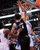 April 10, 2013; Los Angeles, CA, USA; Los Angeles Clippers power forward Blake Griffin (32) scores a basket against the defense of Minnesota Timberwolves center Nikola Pekovic (14) during the second half at Staples Center. Mandatory Credit: Gary A. Vasquez-USA TODAY Sports