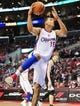 April 10, 2013; Los Angeles, CA, USA; Los Angeles Clippers center Ryan Hollins (15) goes in for a basket against the Minnesota Timberwolves during the second half at Staples Center. Mandatory Credit: Gary A. Vasquez-USA TODAY Sports
