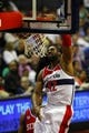 Apr 12, 2013; Washington, DC, USA; Washington Wizards center Nene (42) dunks the ball against the Philadelphia 76ers in the first quarter at Verizon Center. Mandatory Credit: Geoff Burke-USA TODAY Sports
