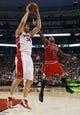 Apr 12, 2013; Toronto, Ontario, CAN;  Toronto Raptors center Aaron Gray (34) gets a rebound as Chicago Bulls guard Nate Robinson (2) defends at the Air Canada Centre. Toronto defeated Chicago 97-88. Mandatory Credit: John E. Sokolowski-USA TODAY Sports