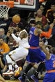 Apr 12, 2013; Cleveland, OH, USA; Cleveland Cavaliers point guard Kyrie Irving (left) loses the ball while driving to the basket against New York Knicks small forward Carmelo Anthony (7) in the third quarter at Quicken Loans Arena. Mandatory Credit: David Richard-USA TODAY Sports