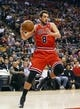 Apr 12, 2013; Toronto, Ontario, CAN; Chicago Bulls guard Marco Belinelli (8) collects a rebound against the Toronto Raptors at the Air Canada Centre. Toronto defeated Chicago 97-88. Mandatory Credit: John E. Sokolowski-USA TODAY Sports