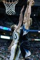 Apr 12, 2013; Salt Lake City, UT, USA; Minnesota Timberwolves small forward Andrei Kirilenko (47) goes up for a dunk while defended by Utah Jazz shooting guard Gordon Hayward (20) during the first half at EnergySolutions Arena. Mandatory Credit: Russ Isabella-USA TODAY Sports